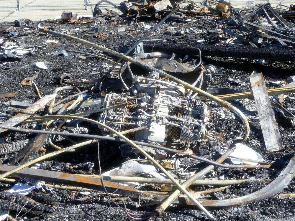 3227-Remains of Airplane- Gyrocopter Muffler Behind It.jpg